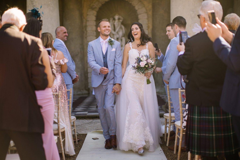 wedding-day-confetti-exit-wotton-house-nisha-haq-photography